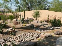 Amazing Desert Landscaping Ideas with Small Plants also Brown Smooth Sands plus Rocks