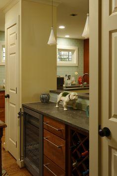 Kitchen remodeling, Daniels Design and Remodeling, hardwood floors, tan cabinets, silver handles, bright lighting, wine chiller, bar area