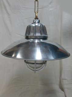 Vintage New Marine Nautical Aluminium Shade with Brass Chain Ship Light   Material: Aluminium Shade Brass Chain  Size Height:  With Chain 54cm Without Chain 28cm  Weight: 1.300kg Approximately