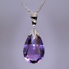 This stylish antique Necklace circa 1910 features a briolette-cut lavender purple Amethyst (the birthstone of February) embellished with Platinum-topped Gold cap and bail, encrusted with Diamonds and accented with glossy black Enamel. Purple Jewelry, Amethyst Jewelry, Amethyst Pendant, I Love Jewelry, Gold Jewelry, Jewelery, Fine Jewelry, Jewelry Design, Amethyst Necklace