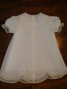 batiste dress with lace, embroidery, and scalloped hem
