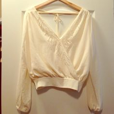 Cream embellished crop top It's a bohemian chic top. Cream colored and made of polyester. It sits right above the waist and puffs up a little. Beautiful embellishments in the front are all intact. No tags but never worn. No rips no stains no defects. All offers accepted. Forever 21 Tops Crop Tops