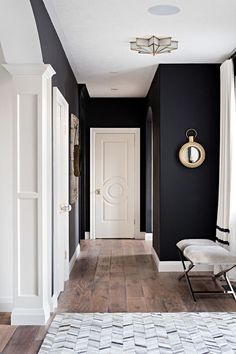 Black and white interiors. The black wall paint color is Benjamin Moore Onyx. Benjamin Moore Onyx The black wall paint color is Benjamin Moore Onyx. White trim paint color is Benjamin Moore Swiss Coffee Sarah St. Black Painted Walls, Dark Walls, White Walls, Light Walls, Style At Home, Black And White Interior, Dark Interior Doors, Black White, Interior Trim