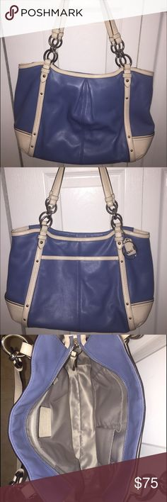 Coach purse Medium sized Coach tote in wonderful condition. Only used a few times. Beautiful periwinkle and white leather accented with silver hardware. Perfect size for everyday purse or carrying documents to and from work or when traveling. Coach Bags Totes