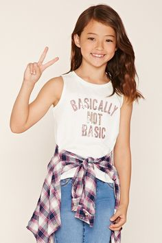 "Forever 21 Girls - A knit top featuring a metallic ""Basically Not Basic"" graphic,sleeveless cut, and a round neckline."