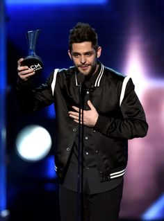 Thomas Rhett Photos Photos - Recording artist Thomas Rhett accepts the Male Vocalist of the Year award onstage during the 52nd Academy Of Country Music Awards at T-Mobile Arena on April 2, 2017 in Las Vegas, Nevada. - 52nd Academy of Country Music Awards - Show