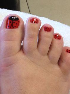 Lady bug nail art with rhinestone eyes