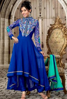 An occasion wear perfect is ready to rock you.   The dazzling royal blue net churidar suit have amazing embroidery patch work is done with resham, zari and stone work.   The entire ensemble makes an excellent wear.   Matching churidar and sea green dupatta is available with this suit.   Slight Color variations are possible due to differing screen and photograph resolutions.
