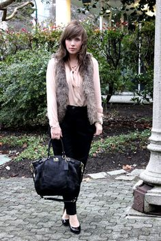 I wear a similar look to the office on casual Fridays in the winter. I wear a long-sleeved white T-shirt, a black faux fur vest, boots and a tassel necklace.