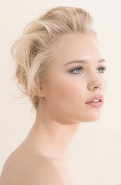 Fair skin, blond hair, blue eyes, natural, peachy blush wedding make-up.