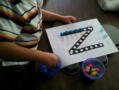 """For fun preschool ideas, I highly recommend the website """"erica confessions of a homeschooler"""". This idea using a metal pan and magnetic pom poms to form ABCs comes from her. Also on YouTube her channel is """"ericashomeschool"""". Check out her awesome """"What's in the workbox"""" video."""