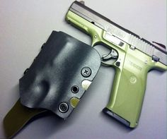 Ruger SR9 with it's new custom kydex rig... OD Green and Black with serrated edges. Www.facebook.com/ccholsters www.twitter.com/consercreek