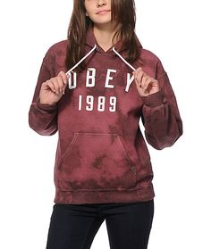 """A vintage inspired """"Obey 1989"""" graphic is printed on the front of a burgundy tie dye hoodie cut from a soft and thick fleece construction for comfort."""