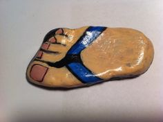 Foot in a Flip Flop Shaped Hand Painted Rock Art