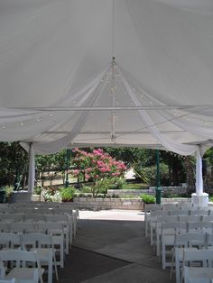 Pretty lights and draping under a tented patio at Whitehall Center