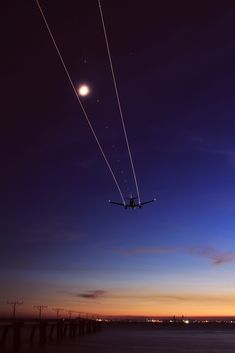 Perfectly stunning photo of airplane taking off into the night.
