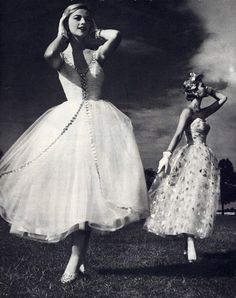 Models in tulle evening gowns.