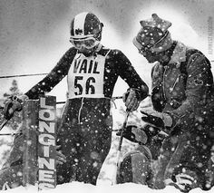 AnneMarie Moser-Proell, Austrian ski star, gets some last-minute instructions from her coach before leaving the starting gate in the Nations' World Series of Skiing at Vail, 1974.