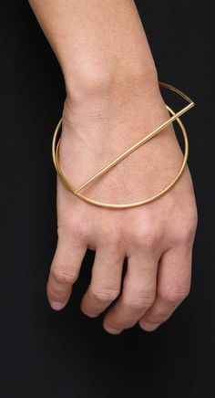 by Gemma Holts. Geometric gold bracelets