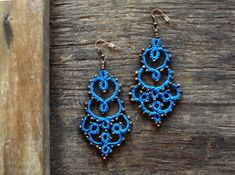 Check out this item in my Etsy shop https://www.etsy.com/listing/480786579/midnight-blue-lace-earrings-tatted