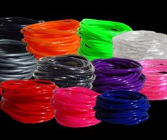 """Since the when several artists wore them for album covers, silicone bracelets (also known as """"gummy bracelets"""" or """"jelly bracelets"""") have been a huge trend. My Childhood Memories, Best Memories, Jelly Bracelets, Silicone Bracelets, Bangles, Kids Growing Up, 80s Kids, Oldies But Goodies, My Youth"""