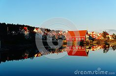 The estate of red wooden cottage on the Norwegian fjord surrounded by water, during an autumn sunset. Mirroring the blue sky and buildings in the water. Telemark region of Norway Wooden Cottage, Wooden Cabins, Campsite, Norway, Buildings, Exterior, Sky, Autumn, Stock Photos