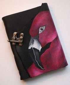 Hand crafted black leather journal. Hand painted with a flamingo which wraps towards the back of the piece. Metal clasp closure and waxed linen threads used for binding. www.oliviajdesigns.etsy.com