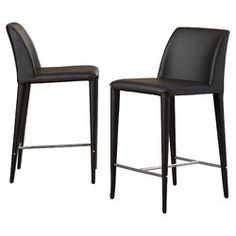 With its chic European profile wrapped in PU leather, the Zackary counter stool brings clean lines and sophistication to a kitchen island or family room bar. This clean-lined European set of two is crafted with a sturdy iron frame.