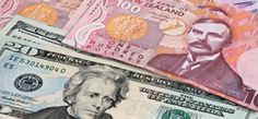 Forex - NZ dollar weaker after central bank signals pause in tightening