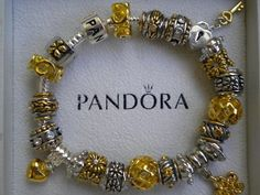 http://www.ebay.com/itm/Beautiful-Pandora-Embossed-Silver-Plated-Bracelet-with-charms/300699592002?ssPageName=WDVW=1=020=164642=ViewItem#ht_1113wt_1159