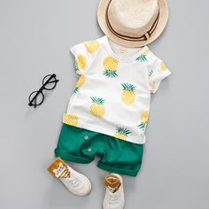 Lovely colors for the summer - Shorts and pineapple print short sleeved tee. Please allow 2-4 weeks for shipping