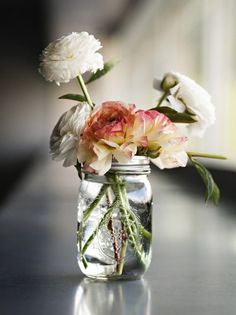 Apartment Decor Ideas: Drop some pretty flowers in a rustic mason jar to brighten up your room.