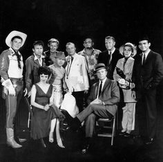 "Guest stars for the premiere episode of The Dick Powell Show, ""Who Killed Julie Greer?"" Standing, from left: Ronald Reagan, Nick Adams, Lloyd Bridges, Mickey Rooney, Edgar Bergen, Jack Carson, Ralph Bellamy, Kay Thompson, and Dean Jones, seated, from left, Carolyn Jones and Dick Powell, wow what a line up"