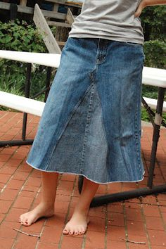 sewing panel in jean skirt   Repurposed jeans into skirt