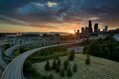 Seattle sunset by Tomas Kaspar. The leading lines from I-5 make this picture beautiful.