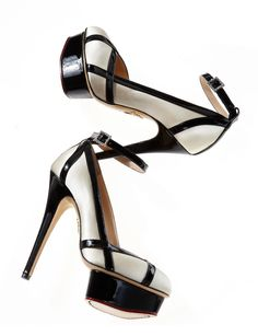 Charlotte Olympia. This reminds me of the napkins you fold and stuff beneath an uneven table leg so it doesn't teeter.