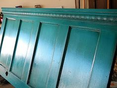 Take an old door, add crown molding, paint, rub in antiquing, and hang on the wall behind your bed for a beautiful HEADBOARD. I just love this colour too!