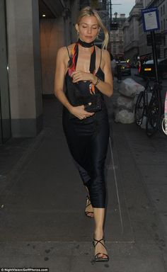 Minimal: She kept her look co-ordinated with barely-there black heels and a matching clutc...
