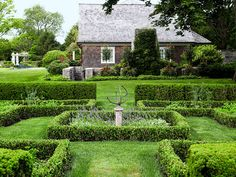 The garden owes its bone structure to elements like these hedges. Lavender flourishes around the armillary.