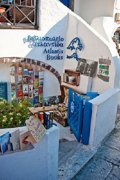 Don't you wanna curl up here with a book and coffee?  Atlantis Books in Santorini, Greece.
