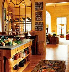 What a great idea to use a beautiful window to separate the kitchen from the living area.