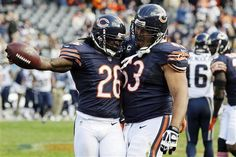 Chicago Bears cornerback Tim Jennings (26) celebrates with center Roberto Garza (63) in the second half of an NFL football game in Chicago, Sunday, Sept....