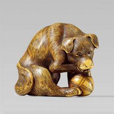 A fine wood netsuke of a male dog. Late 18th century, Auktion 1092 Asiatische Kunst I Indien, Südostasien und Japan, Lot 691