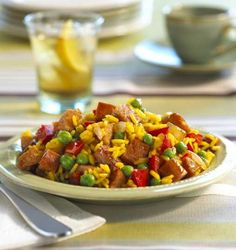 Chicken Smoked Sausage with Rice - Kick it up a notch with Hillshire Farm<sup>®</sup> Hardwood Chicken Smoked Sausage, sweet onion, juicy peppers, peas, green olives and rice.