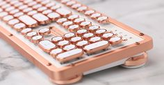 We're Upgrading Our Desk with This Super-Pretty Rose-Gold Keyboard via @PureWow