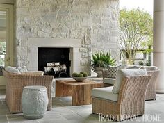 Outdoors furniture, wicker, wood, white coushins and end table moroccan style....House Tour: Stone House