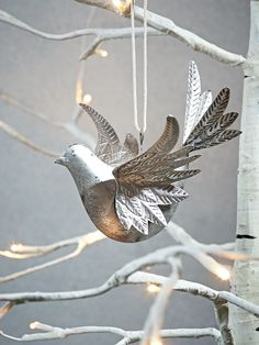 Made from lightweight iron with a rustic silvered finish, our decorative bird decoration features embossed metal wings and tail and simple cord loop for hanging. Christmas Traditions, Christmas Themes, Christmas Crafts, Christmas Ornaments, Christmas Colors, Silver Christmas, Country Christmas, All Things Christmas, Metal Wings