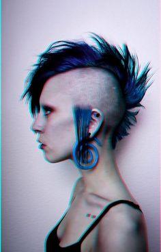 deathhawk, punk girl, shaved side hairstyle, alternative girl, blue hair, piercing, goth girl by FuturisticNews.com
