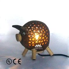It's a lamp.  Made out of coconut shell.  Shaped like a pig.  Perfect for the pool house/pig pen!