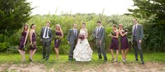 Saltwater farm vineyard wedding, wedding party bridesmaids groomsmen posed photo, grey suits plum purple grape dresses